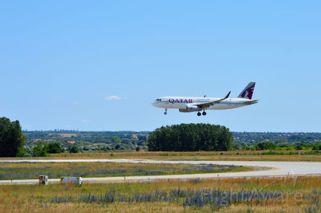 Airbus A320 (A7-AHX) - On final approach RWY 31R