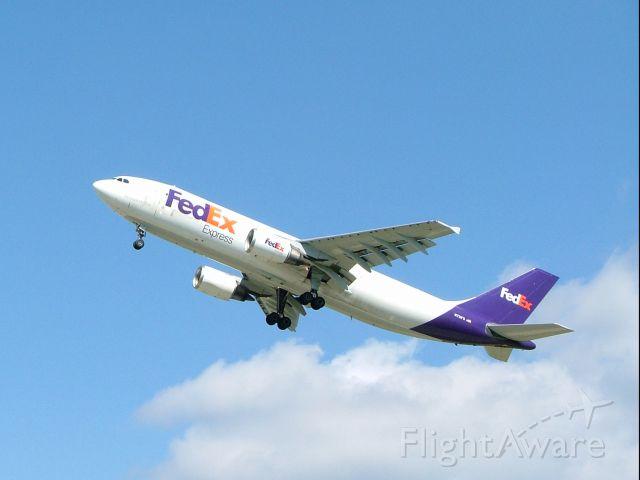 — — - FedEx A300 on takeoff from 26L