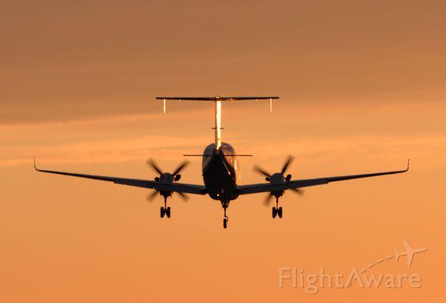 Beechcraft 1900 (C-FEVA) - Flying into the sunset off runway 31 at Gander, Canada.