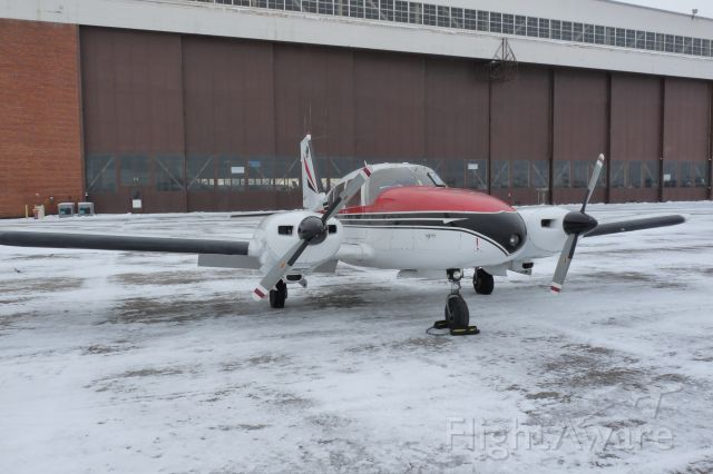 Piper Apache (N6521Y) - On the frozen ramp at RME.