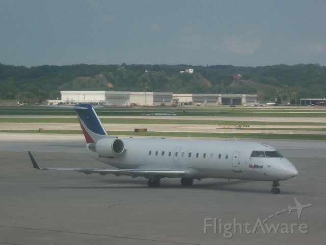 Canadair Regional Jet CRJ-200 (N988CA) - SkyWest 9753 from MKE.  This was the last mounth Sky West served Omaha (August 7,2011).
