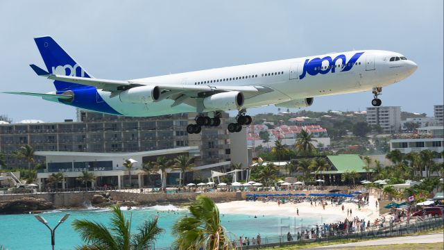 Airbus A340-300 (F-GLZP) - Joon flying for Air France Airbus A343 F-GLZP over maho beach for landing at TNCM St Maarten