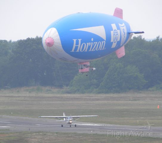 — — - Horizon Blue Cross Blue Shield blimp coming in to land at KBLM. I don