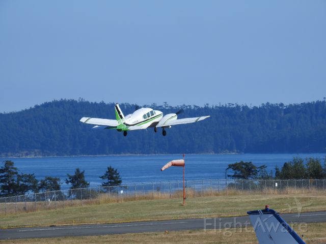 Piper Aztec (N927PT) - Albion Air taking off from Friday Harbor to Portland (FHR - UAO). Photo by Steven K. Roberts, 83X zoom (Nikon P900), July 23, 2017