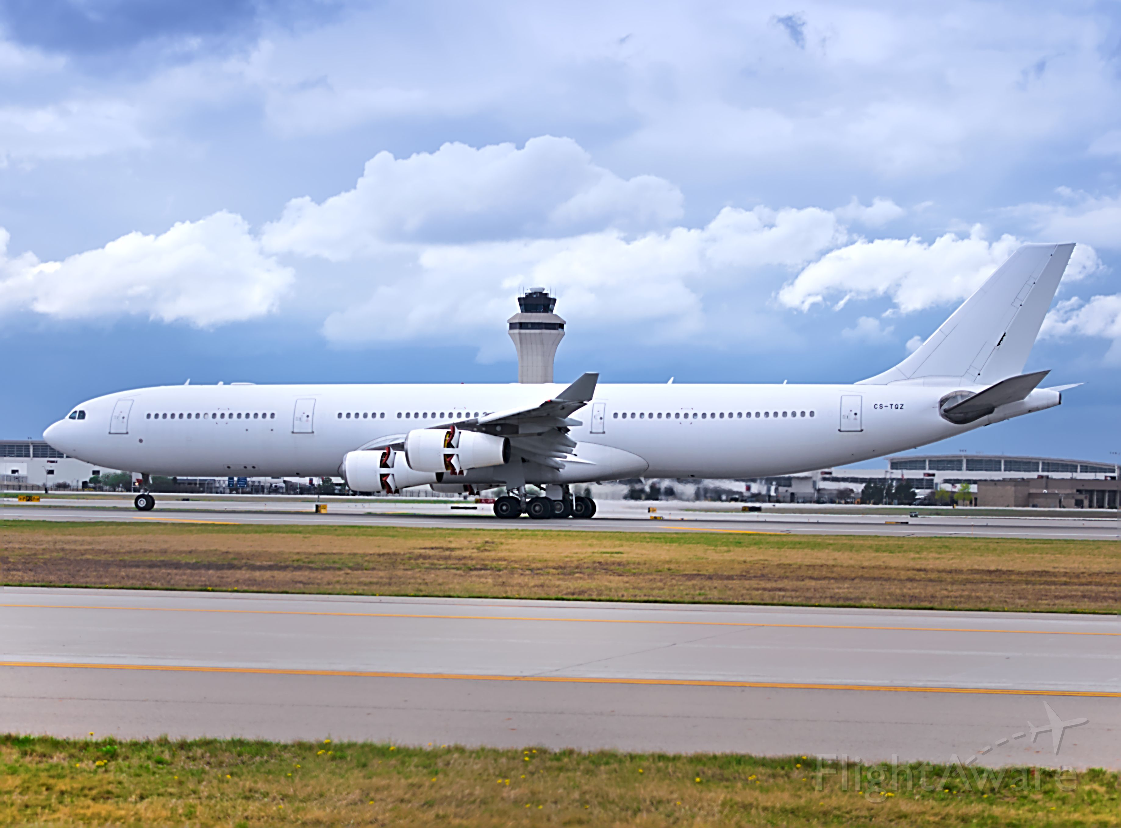 Airbus A340-300 (CS-TQZ) - Hifly 853 slowing down on runway 21L from Lisbon.<br /><br />4/12/2021