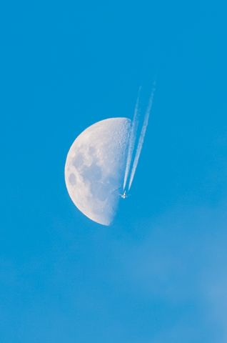 Airbus A320 (ZK-OJQ) - An Air New Zealand A320-232 zooming through the sky and past the moon as Flight NZ678 enroute to Auckland from Dunedin flying overhead Christchurch.