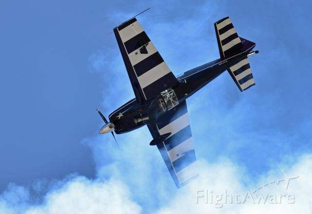 EXTRA EA-300 (N46EX) - Vicky Benzing falling back into her own smoke trail after flying straight up during her performance at the 2015 Hollister Airshow.