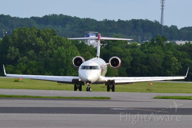 Canadair Regional Jet CRJ-700 (N520JG) - JOE GIBBS RACING INC arriving at KJQF - 5/30/18