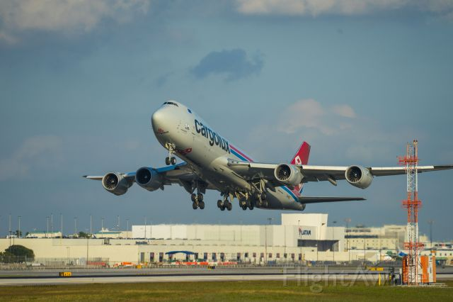 LX-VCL — - Departure of Cargolux Flight from Miami International Airport on Runway 27.