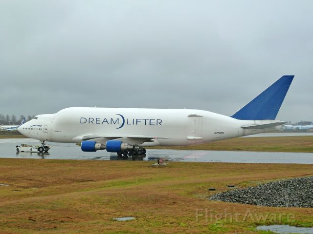 Boeing 747-400 (N718BA) - 1-28-2011 Dreamlifter 747-407 LCF, N718BA is being pushed from the Boeing ramp east of the main runway at Paint Field in Everett, Washington to the back side of the Future of Flight Aviation Center in Mukilteo, Washington.  The Flight Center often puts on shows for visiting subcontractors who come to Mukilteo / Everett to take the Boeing Tour. The Dreamlifter, the worlds largest plane in cargo volume, is always a major attraction.     Photo taken from the Flight Center / Paine Field fence line by Bruce McKinnon