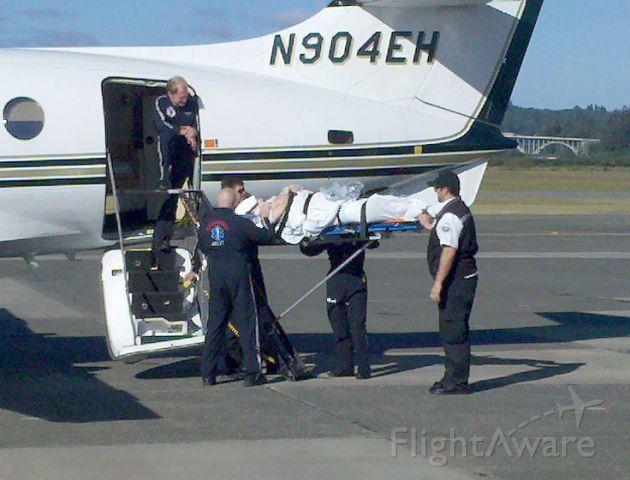 British Aerospace Jetstream 31 (N904EH) - Air Ambulance Team loading a patient.