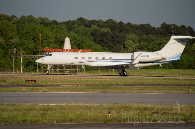 Gulfstream Aerospace Gulfstream V (N55BM) - Departing from PDK airport.  Photographed from the observation stand.