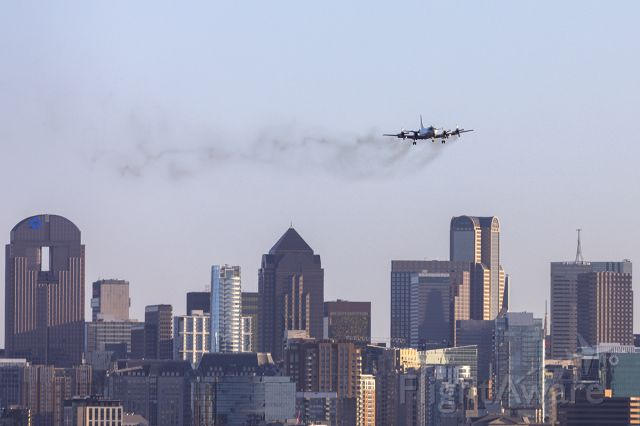 Lockheed P-3 Orion (16-1589) - A smoky P3 arriving over the Dallas skyline from Jacksonville.