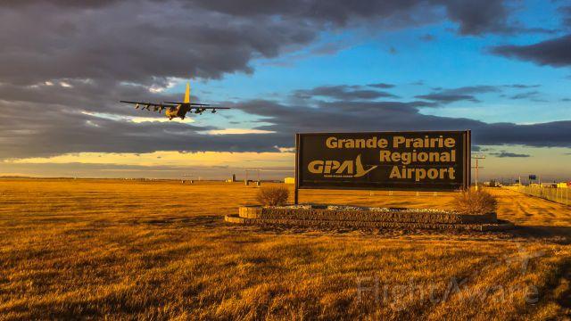 Lockheed C-130 Hercules (13-0341) - Lockheed C-130 Hercules arriving on runway 12/30 in YQU Grande Prairie, AB