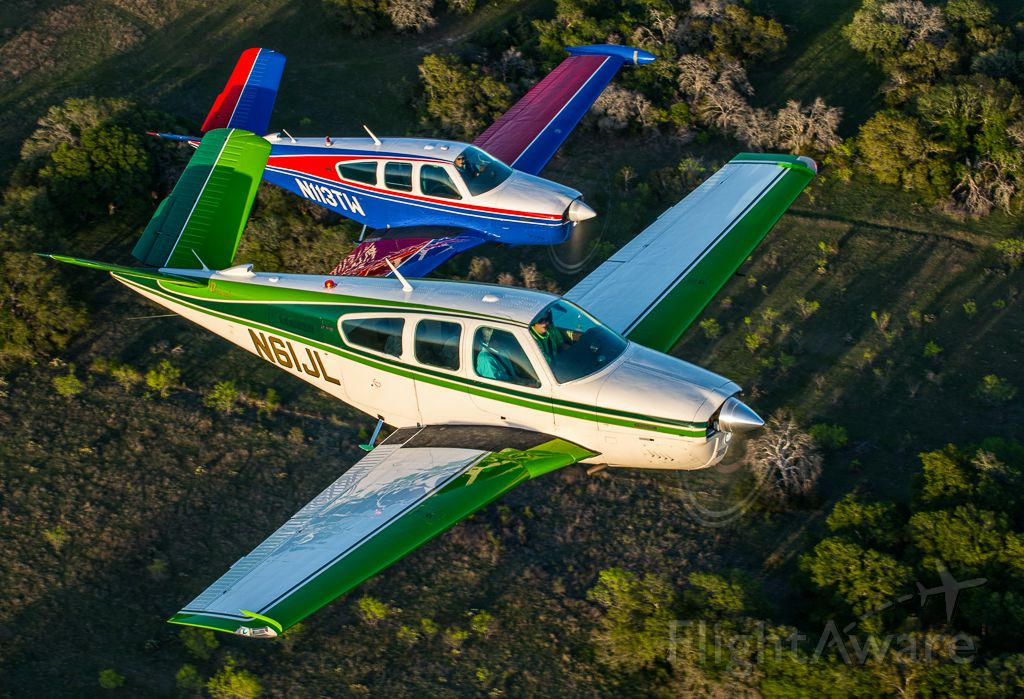 """Beechcraft 35 Bonanza (N61JL) - N61JL and N113TW in close formation in the Lake Travis area.  Picture taken by Glenn Watson of Mach Point One Aviation (<a rel=""""nofollow"""" href=""""http://www.machpointoneaviation.com/"""">http://www.machpointoneaviation.com/</a>)"""