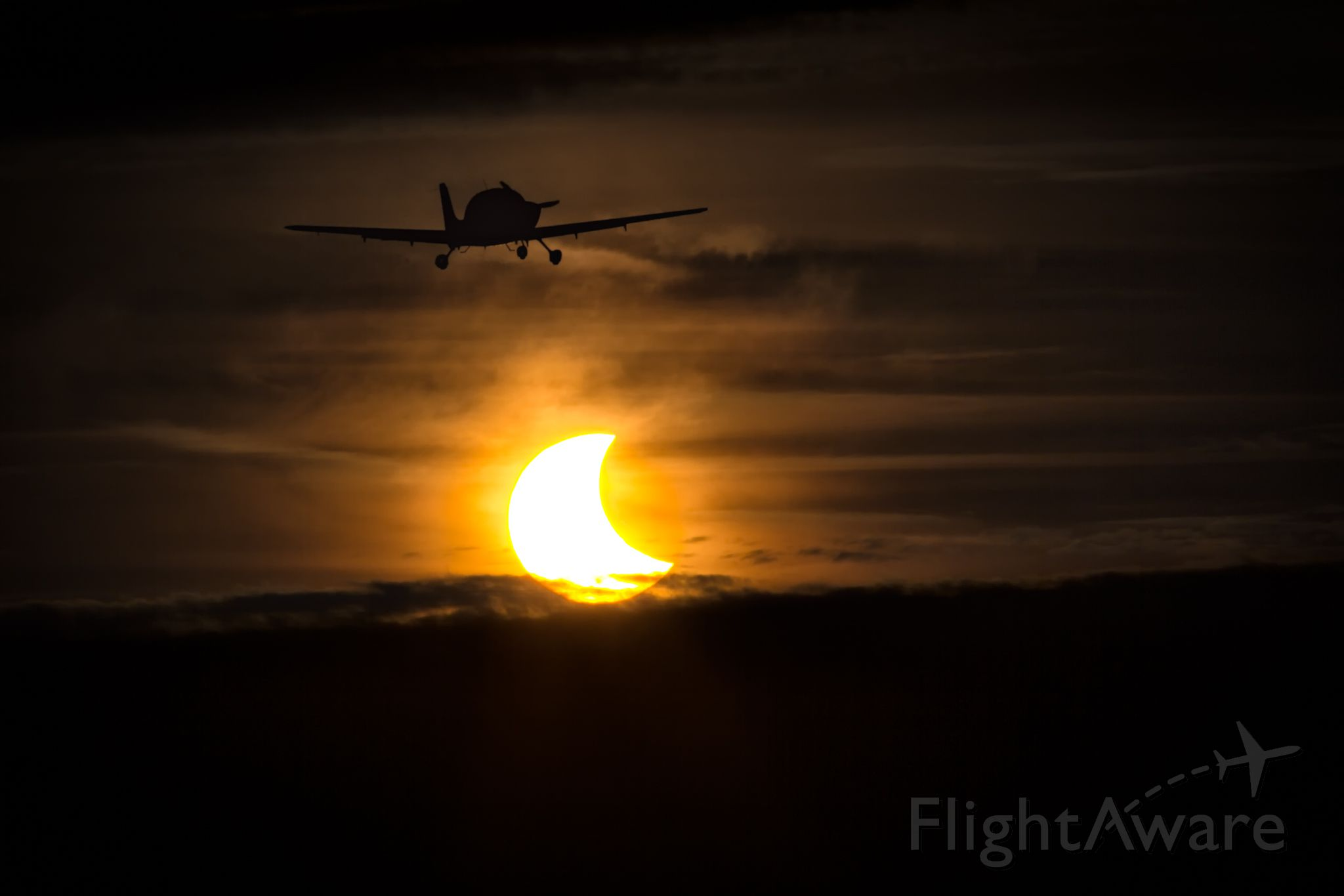 """Cirrus SR-20 — - A Cirrus departing Pontiac Airport during the height of the Oct. 23 Solar Eclipse.<br /><br /><a rel=""""nofollow"""" href=""""http://www.adler-photo.com"""">www.adler-photo.com</a>"""