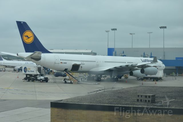 Airbus A340-300 (D-AIGZ) - A Lufthansa Airbus A340-313 sits at Gates D5A/B. This shot is no longer possible as the terminal I'm shooting from has been demolished. Photo taken 10/3/2016.