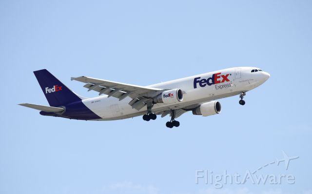 Airbus A300F4-600 (N719FD) - Fedex 3640 from Seattle.  Beautiful spring day in Indianapolis.  One of the last A300 still flying, serial number 388. Delivered in 1986 to Korean Airlines.