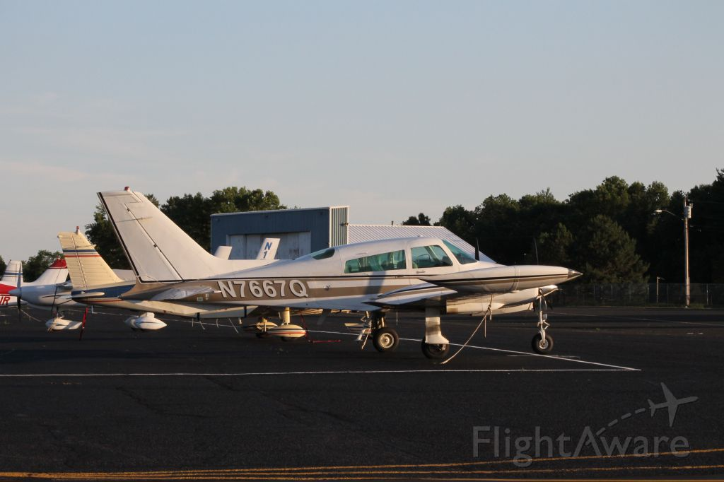 Cessna 310 (N7667Q) - Parked at the ramp