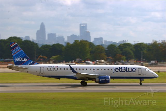 N339JB — - 339JB taking off on Rwy 18C with the City of Charlotte in the background