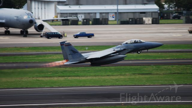 — — - An F-15C Eagle taking off in afterburner to head out for some weekend training.