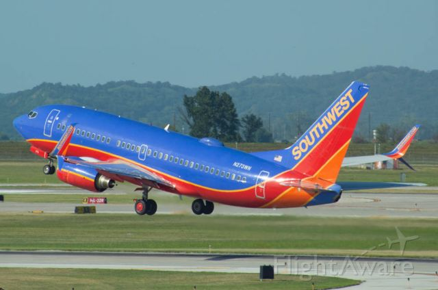 Boeing 737-700 (N273WN) - Southwest 591 is climbing out of Omaha's Runway 32L for Chicago Midway at 5:35 PM.  Photo taken August 6, 2019 with Nikon D3200 at 400mm.  This image was taken from a new spotting location inside the new car rental facility.  The building has floor to celling windows with an amazing view of 14R/14L and gates B11-B13.