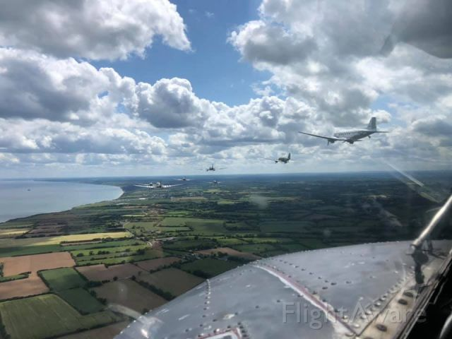 — — - The Normandy 75th Anniversary formation of C-47's courtesy of Miss Montana.