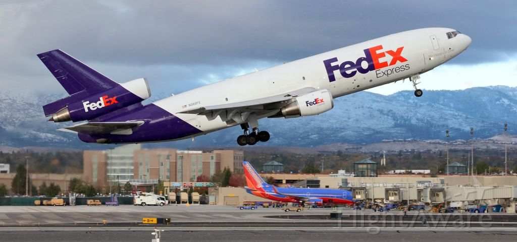 """McDonnell Douglas DC-10 (N360FE) - As a few flakes of snow begin falling from a dark cloud, Fed Ex's """"Annibel"""" (N360FE) is off 34L and on the climb out of RNO."""