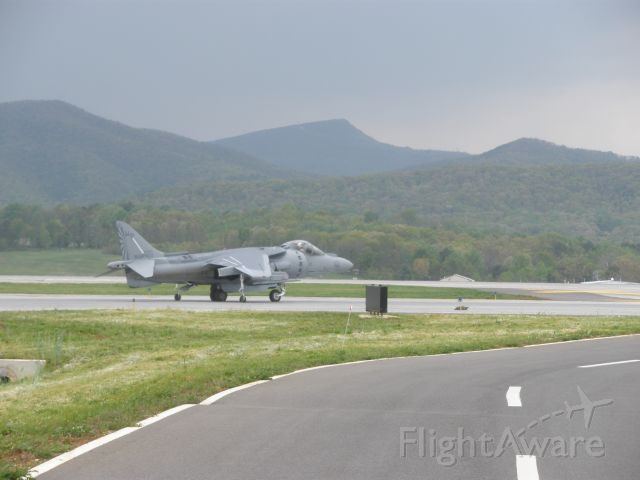 — — - Taxi for departure to runway 24 in Roanoke,Va.The sharp mountain peak in back ground is Mc-Afees Knob.