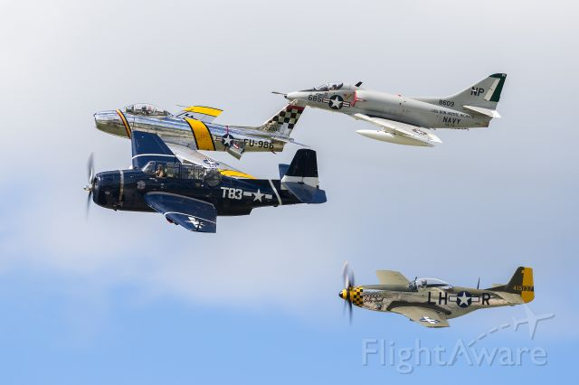 """North American P-51 Mustang (N251PW) - USAF Heritage / USN Tailhook Legacy Flight featuring (top to bottom) Douglas A-4 Skyhawk, North American F-86 Sabre, GRUMMAN TBM-3E Avenger, and the P-51D """"Baby Duck"""" at the 2016 Northern Illinois Airshow (formerly known as Wings Over Waukegan)."""