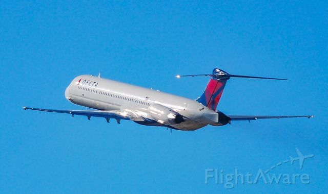McDonnell Douglas MD-88 (N984DL) - Taking off into the clear blue sky.