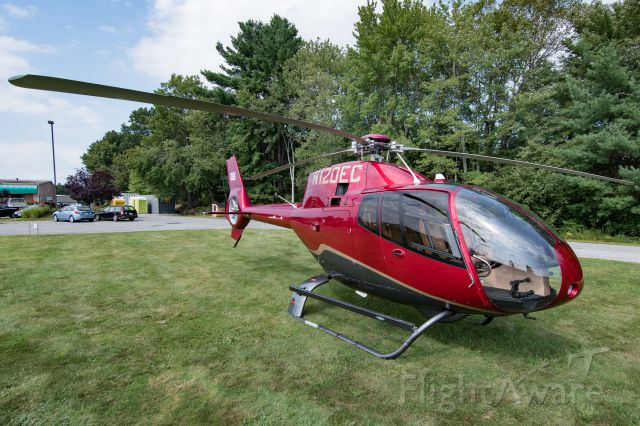 """HARBIN HC-120 (N120EC) - 120EC sitting in the parking lot at Minute Man Municipal. I guess that's one way to avoid airport fees! This helicopter had a brief cameo in the 2016 """"Superman vs Batman"""" movie."""