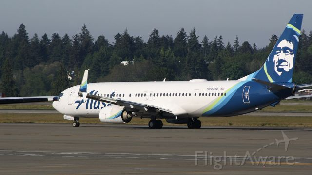 Boeing 737-700 (N402AS) - Picture taken from inside the terminalbr /Alaska 73 just taxiing by