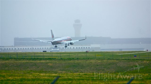 BOEING 767-200 (N646AA) - American Airlines 757 landing at DFW during some bad fog.