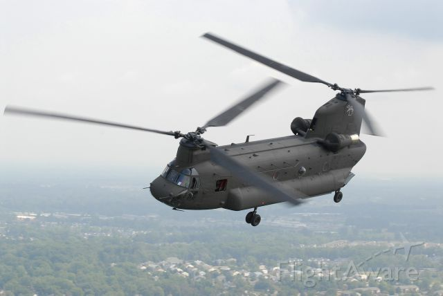 — — - Michigan Army National Guard CH-47D flying over Michigan.
