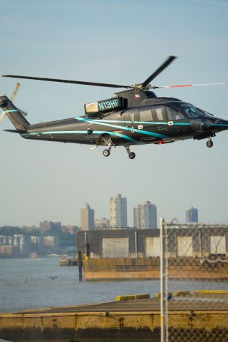 Sikorsky S-76 (N13HF) - Captured several helicopters, including this one, while walking on the west side of New York City.