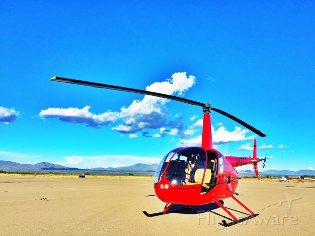 Robinson R-44 (N133CC) - Cape Copters R44 on the ramp at Kanab Utah, Paul Salmon taking students on a long cross country