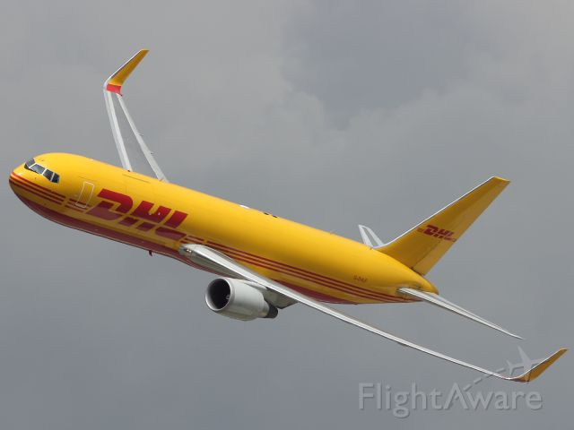 — — - It wasn't all fighters and bombers at RIAT 2012. Here we see a DHL B767-336ER run through an impressive low level flying display. Make a nice change of pace for the pilots, used to hauling cargo around the globe!