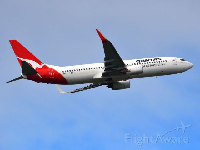 Boeing 737-800 (VH-VYF) - Getting airborne off runway 23 on a cold, gloomy winters day. Wednesday 4th July 2012.