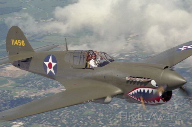 CURTISS Warhawk — - P-40 over Wisconsin. Pilot Dick Wixom. Photographed by Larry Wixom.  Photo Plane was a C-170!