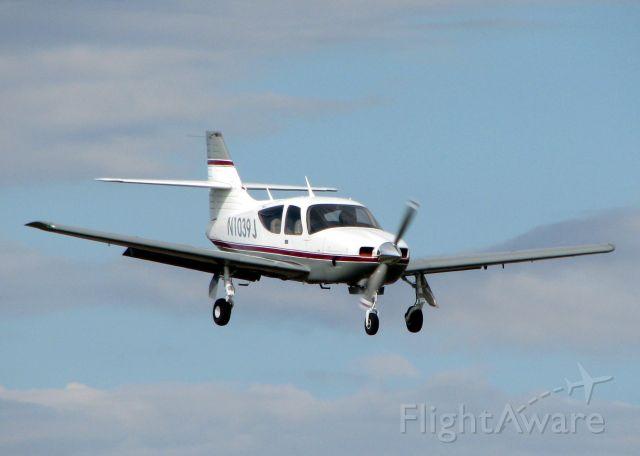 Rockwell Commander 114 (N1039J) - Landing on runway 14 at the Shreveport Downtown airport.