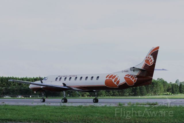C-FAMC — - Bearskin Airlines Fairchild taxis to takeoff position runway 25 2010:08:17. 17:36
