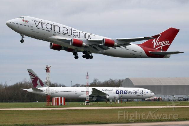 Boeing 747-400 (G-VXLG) - VIR75 off to Orlando as QTR27 taxies to the gate after arriving from Doha.