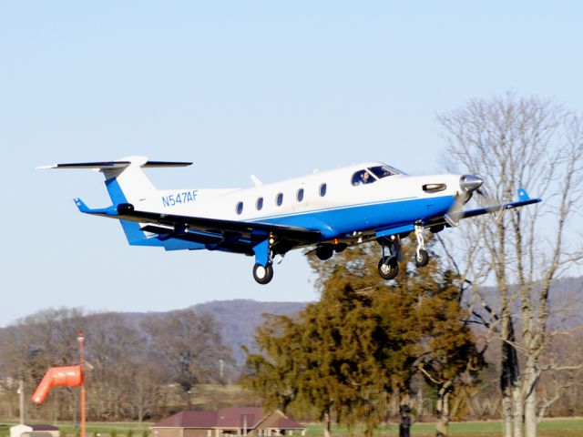 Pilatus PC-12 (N547AF) - Effortlessly lifting off on a gorgeous day in Tennessee after dropping off some ladies on their return leg from Mardi Gras.