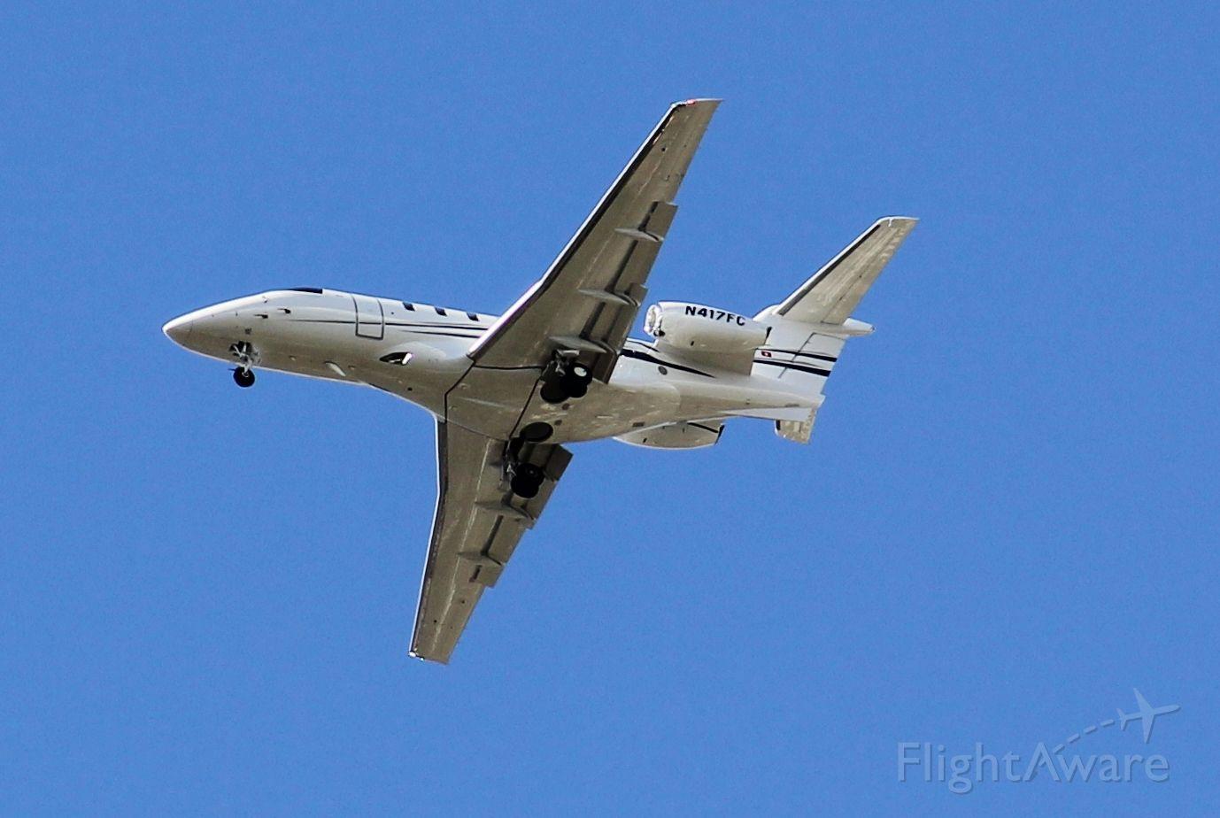 Pilatus PC-24 (N417FC) - Wheels down, making final approach to Orlando International. MCO<br />Clear skies, runway in sight.