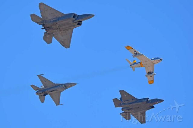 Lockheed F-35C (14-5095) - North American F-86F Sabre NX186AM, Lockheed-Martin F-35A Lightning II 14-5095, Lockheed-Martin F-22A Raptor, and Lockheed-Martin F-16CJ Block 50 Fighting Falcon 01-7050 participating in the Air Force Heritage Conference at Davis-Monthan AFB on March 4, 2018.
