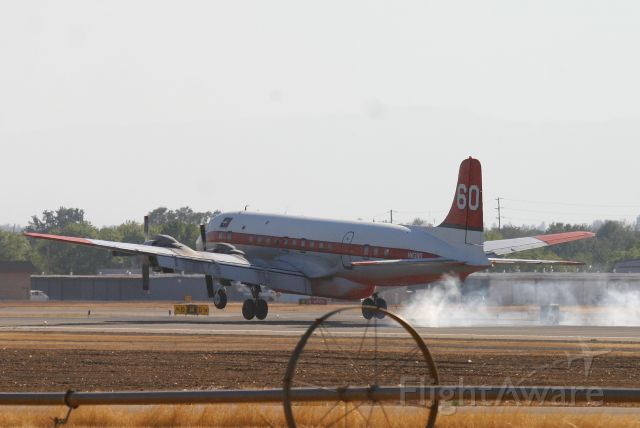 Douglas DC-7 (N838D) - KRDD - DC-7B N838D of Erickson Aero Tankers landing at Redding during the Boles Fire Sept 2014. This Air tanker saved the day on the Boles fire making many critical Phos-chek drops to quell the fast moving fire started by an idiot in Weed,CA. Hit full for large image.