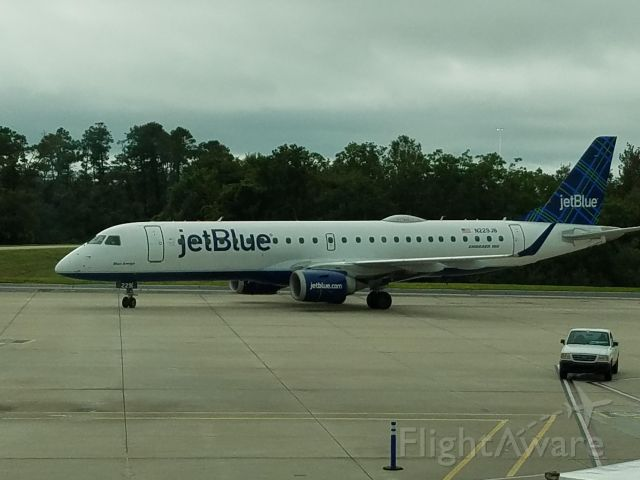 "Embraer ERJ-190 (N229JB) - Took this pic of JetBlue Embraer 190, under the name ""Blue Amigo"", as it taixed to the gate, in which would fly me home to DCA."