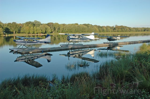 Cessna Skywagon (C-FCXN) - 3 float planes resting at the dock at Orillia/St. John Water Aerodrome (September 17, 2019) From left to right: Cessna A185F (C-FCXN - 185-02243), De Havilland DHC-2 Mk.I (C-FZXD - 1335), and Aeronica 11CCX Chief (C-FEVZ - 11CC-249X).