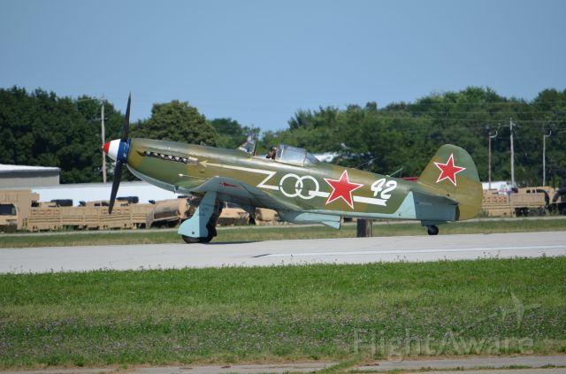 YAKOVLEV Yak-9 (NX1157H) - EAA 2011 YAK-9, (a beautiful and underrated aircraft) taxiing back to warbirds area.